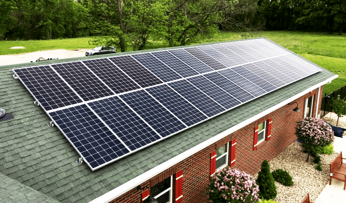 Residential roof mounted solar system near pool in Alton, IL